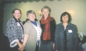 AAUW members Margo Johnson, Janet Richardson, Terry Whaley, and Helen Wang pause for a photo at the January Interbranch luncheon.