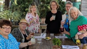 """Houston area AAUW Members (l-r) Margie Poole, Margo Johnson, Debbie Campbell, Anouk Boon, Marie Helmy, Karen North (holding """"Teddy"""") at Tiny Boxwoods to bid a fond farewell to Anouk."""
